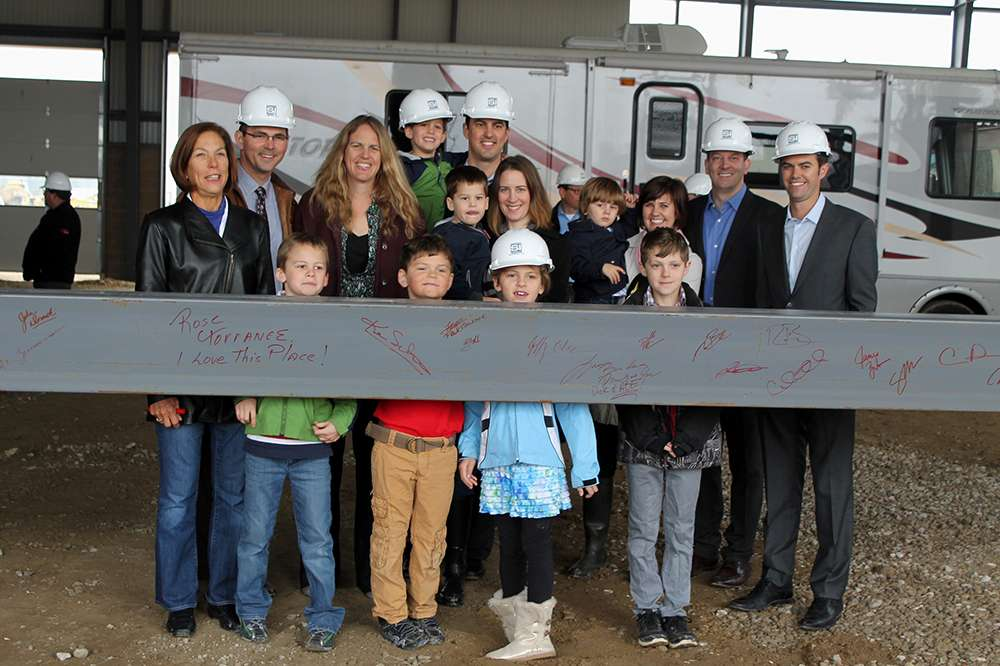 The Baidas Family Gathers In Front Of The Last Beam