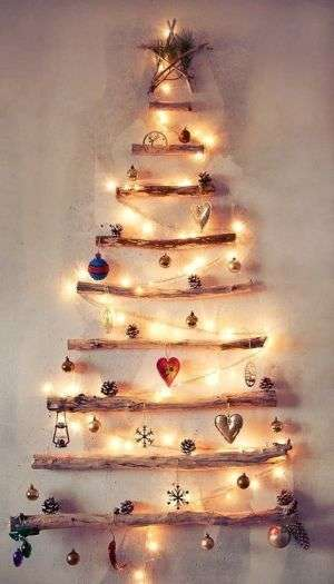 create a christmas tree made from sticks ornaments