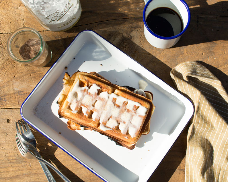 Cinnamon roll waffles made in a pie iron