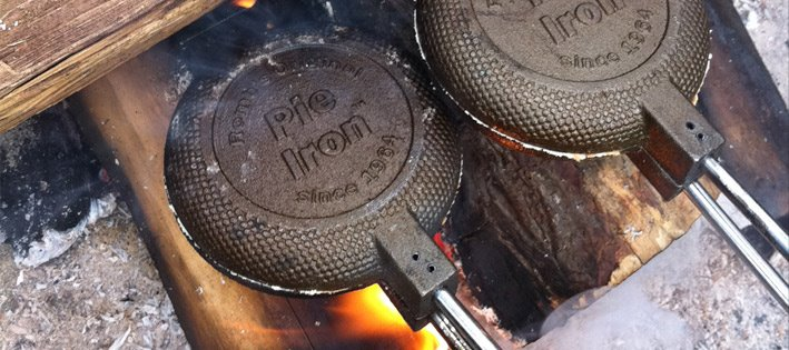 pie iron desserts cooking over a campfire