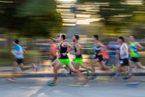 Runners zoom past the camera