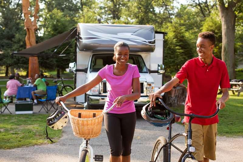 teens biking at an RV campground