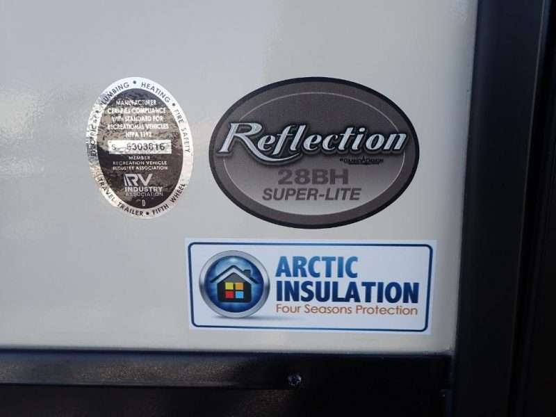 A common RV myth about Arctic Insulation packages is busted; here is an RV with an Arctic Insulation logo