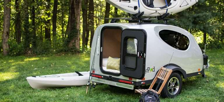 Little Guy MyPod trailer in the woods with fishing equipment