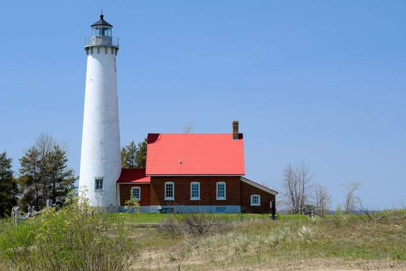 Visit Tawas Point Lighthouse, built in 1876, when you camp at the Tawas Point State Park, near Lake Huron, Michigan.