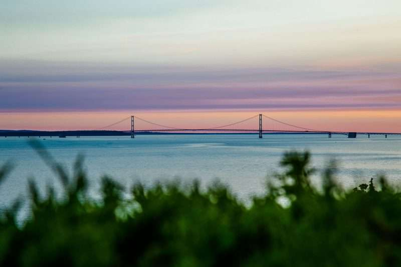 The Mackinac Bridge is visible from Mackinaw Mill Creek Camping - one of the best campgrounds in Michigan.