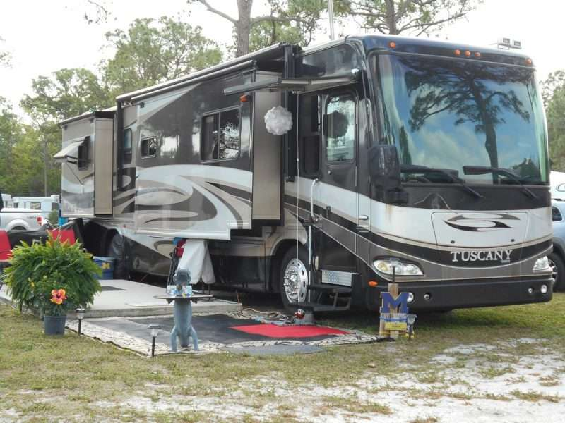 A Class A motorhome RV on a campsite at the West Palm Beach/Lion Country Safari KOA campground in Florida.