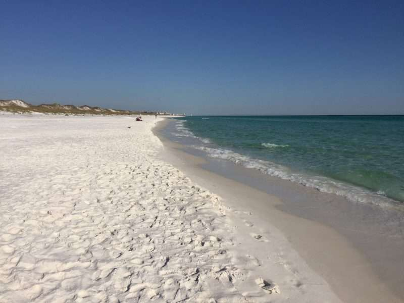White sandy beach at Topsail Hill Preserve State Park in Santa Rosa Beach, Florida.