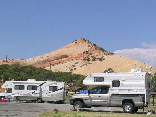 Two RVs are parked at Red Fleet State Park campground in Vernal, Utah.