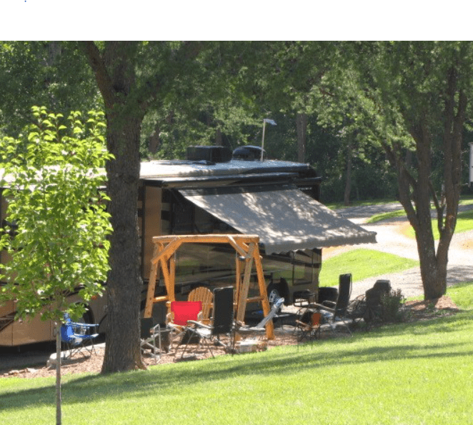 A Class A RV motorhome on a campsite at Logan/Hocking Hills KOA campground in Ohio.