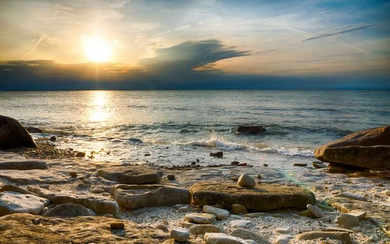 The sunset over Lake Erie as seen from the rocky coast of Kelleys Island.