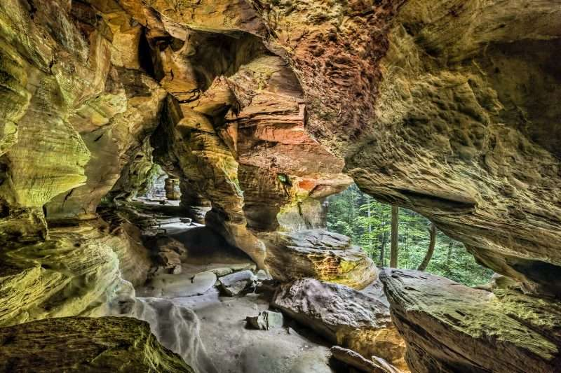 Rock formation in Ohio called Rock House has several portals that look into the forest.
