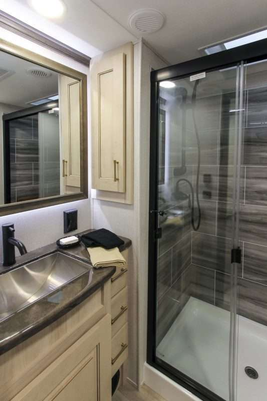 The huge residential shower and vanity of the Alliance Paradigm 310RL.