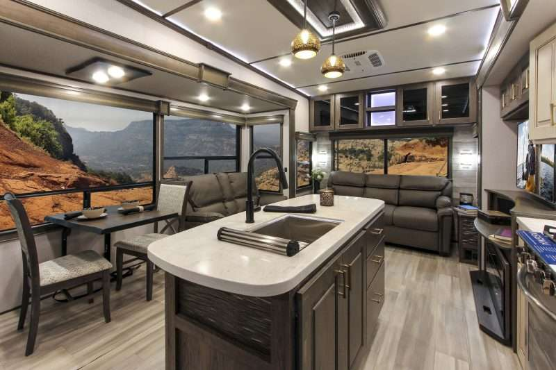 The open layout of the Alliance Paradigm 310RL includes a beautiful kitchen, living and dining area with a beautiful kitchen island in the center.