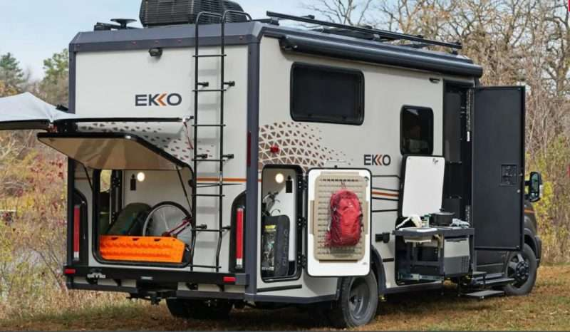 The storage compartments on a Winnebago EKKO motorhome are opened to show its cargo carrying capacity.