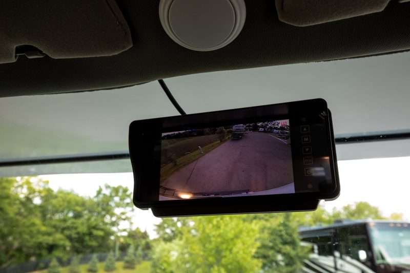 The rearview mirror of the Entrada Class C motorhome has an integrated monitor to view the backup camera.