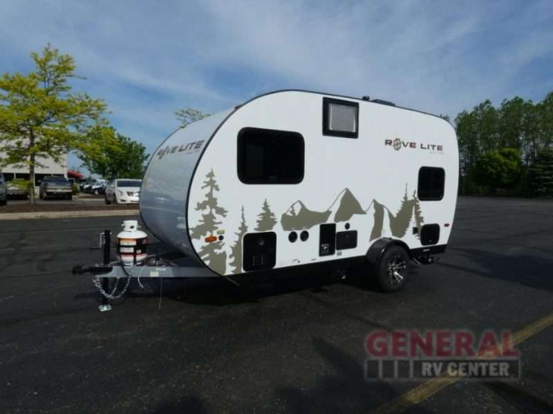 The exterior of the Rove Lite teardrop trailer is white and features olive green graphics of a mountain peak and tall trees.