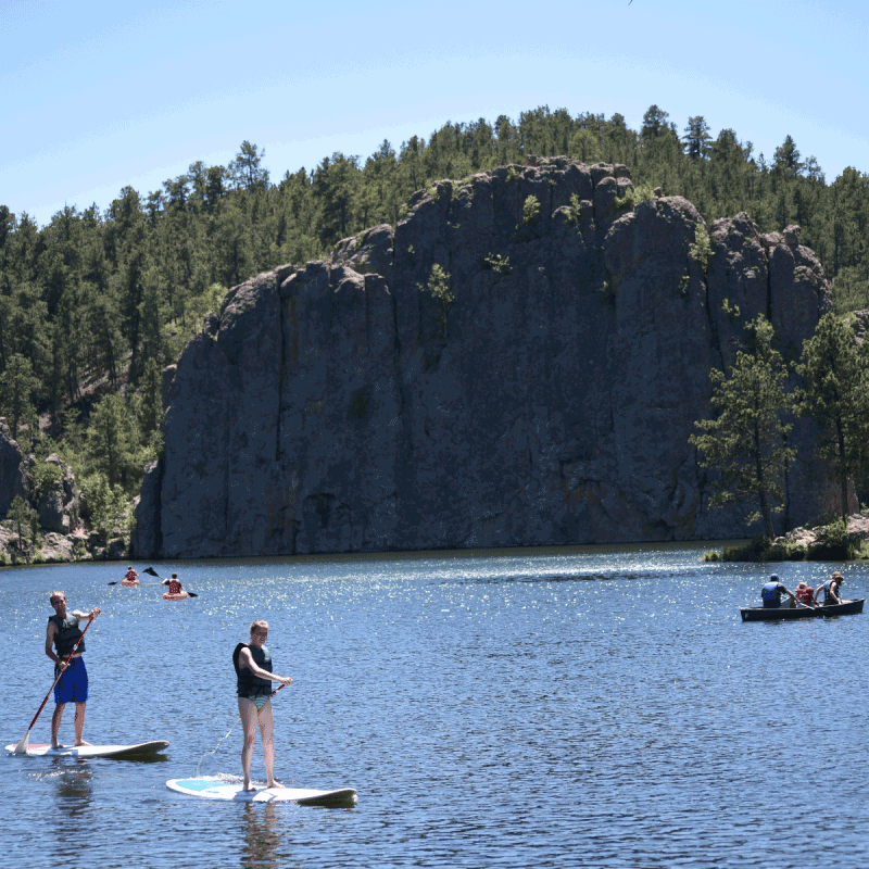 People paddle board, kayak, and boat at Custer State Park.