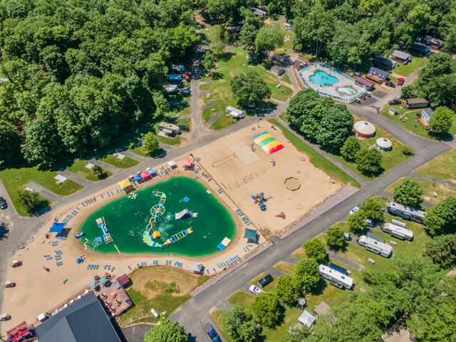 A view from above shows the large swimming and recreation area at Merry Mac's Campground. The sandy beach is the perfect place for RVers to stay and play.