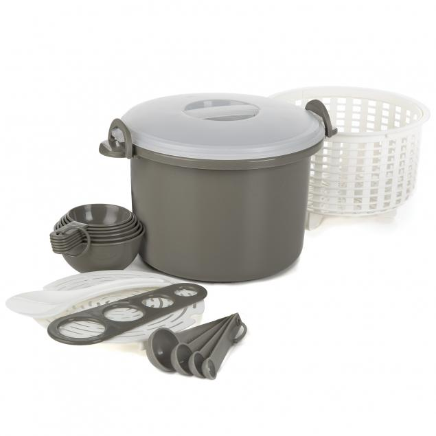 A plastic rice and pasta cooker set includes a gray plastic pot with clear lid, a white straining basket, gray nesting measuring cups and spoons, a gray pasta measuring tool, and a white rice serving spoon.