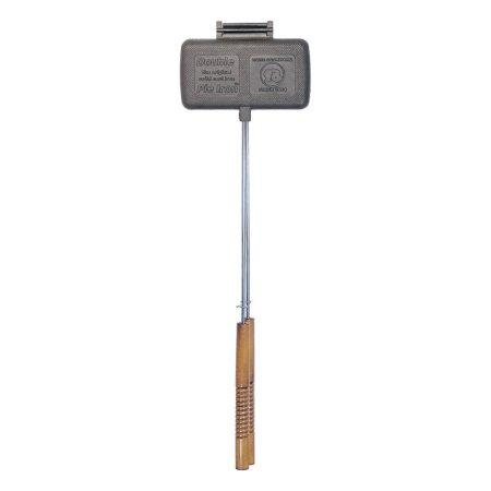 A cast iron double-sized pie iron is large enough to make two pie irons at the same time. This cooking tool is double the width of the original pie iron and features a long handle with wooden grips so you can hold your pie iron over the fire securely.